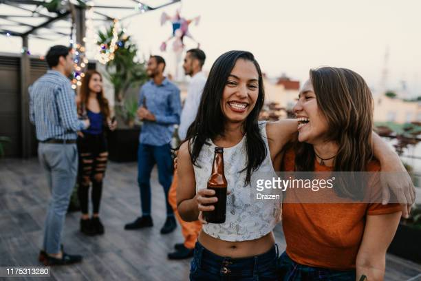 young people dancing on party in latin america - mexican beer stock pictures, royalty-free photos & images