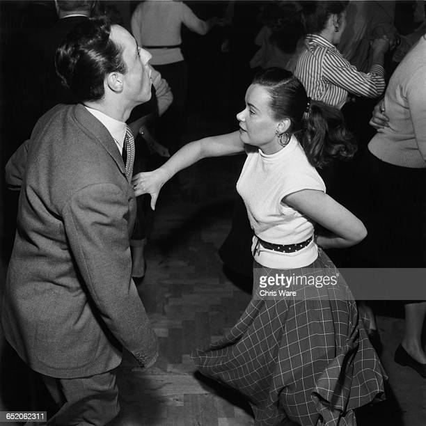 Young people dancing to Humphrey Lyttelton's band at the 100 Club a jazz club at 100 Oxford Street London May 1954