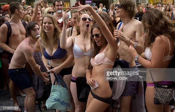 Young people dressed in their underwear wait outside a Desigual fashion store for the 'Semi naked party'' offer on June 21 2013 in central Prague...