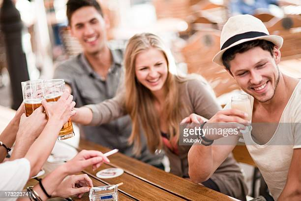Young people drinking beer and juice outdoors