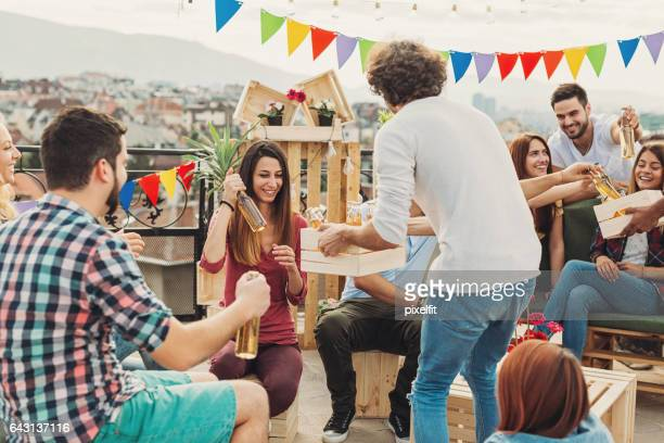 Young people drinking beer on the roof