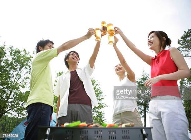 Young people drinking beer with barbecue
