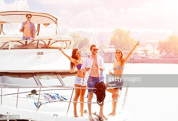 young people drive yacht and having fun - millionnaire stock photos and pictures