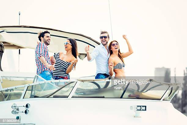Young People Drive Yacht and having fun.