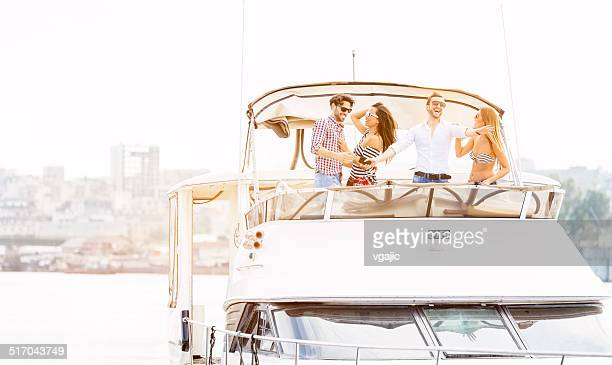 young people drive yacht and having fun. - luxury yacht stock pictures, royalty-free photos & images