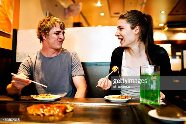 Young people eating in Japanese restaurant, Tokyo.