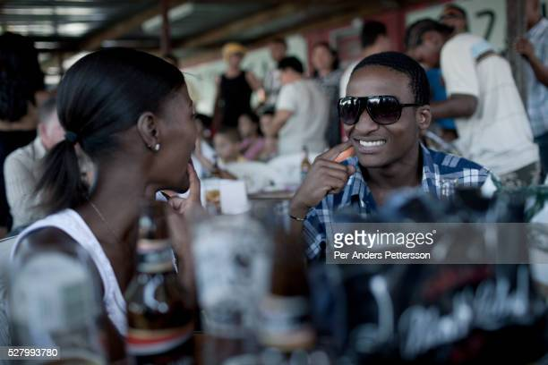 Young people enjoy themselves at Mzolis a restaurant in Guguletu a township outside Cape Town South Africa