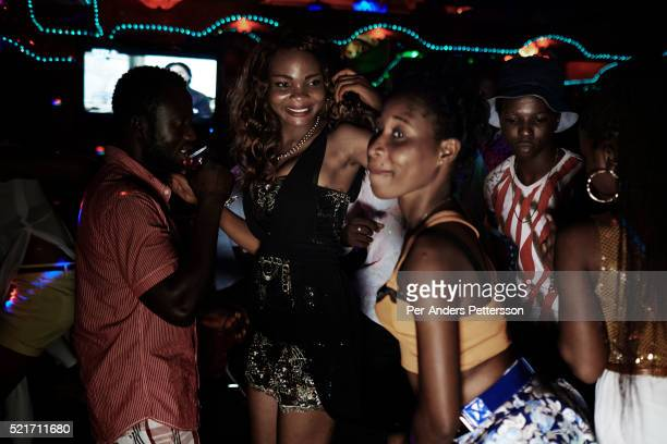 Young people enjoy themselves in a club on April 18 2015 in Accra Ghana Many of the customers in this club are involved in Romance scams credit card...