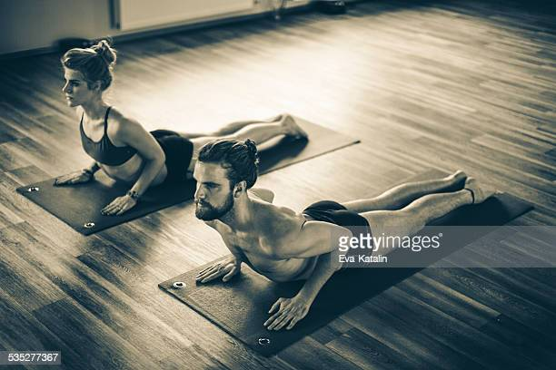 Young people exercising bikram yoga
