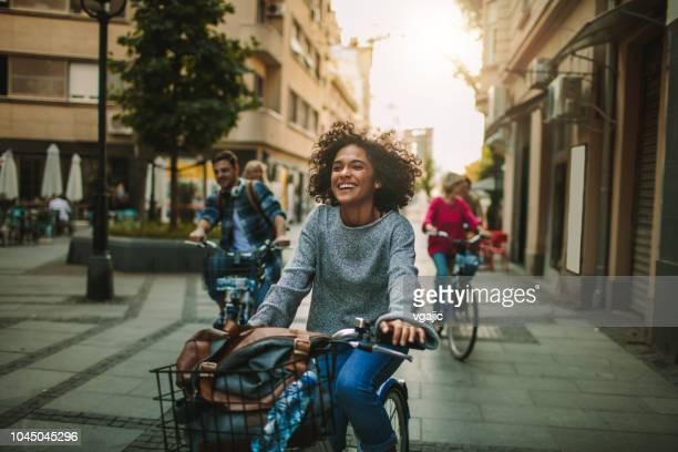 young people exploring the city on bicycles - cycling stock pictures, royalty-free photos & images