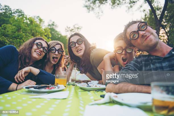Young people fooling around during birthday party