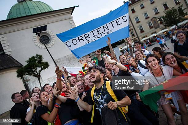 Young people from Argentinia celebrate at the market square on July 25 2016 in Krakow Poland Catholic youths are traveling to Poland for the official...