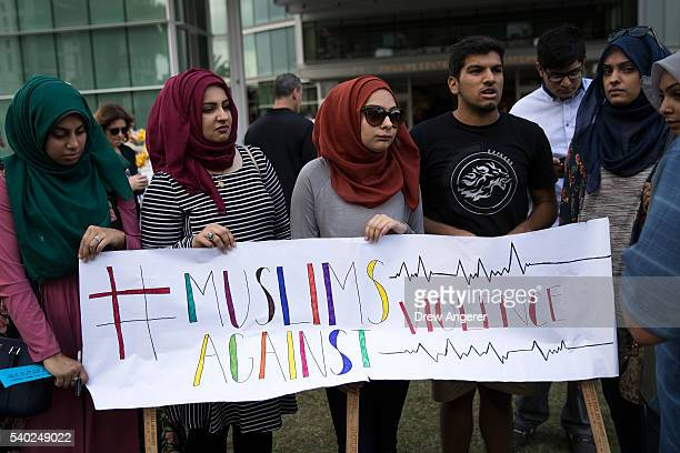 Young people from Husseini Islamic Center in Sanford Florida hold up a sign as they visit a makeshift memorial at the Dr Phillips Center for...