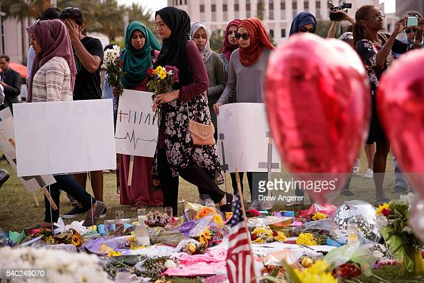 Young people from Husseini Islamic Center in Sanford Florida visit a makeshift memorial at the Dr Phillips Center for Performing Arts June 14 2016 in...