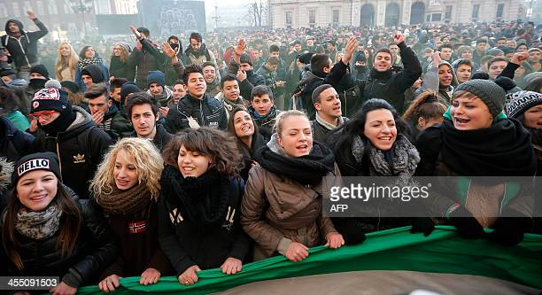 """Young people gather and shout slogans as they take part in a protest against austerity measures in """"Piazza Castello"""", in Turin on December 11, 2013...."""