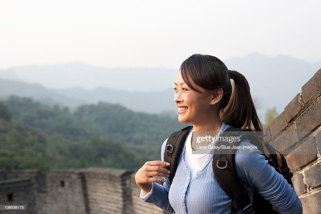 Young people go hiking on the Great Wall : Stock Photo