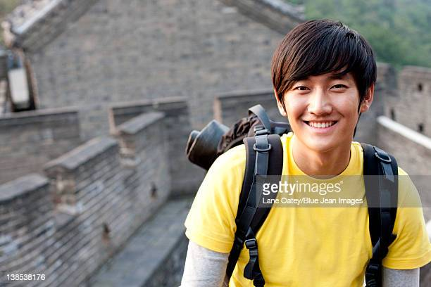 Young people go hiking on the Great Wall