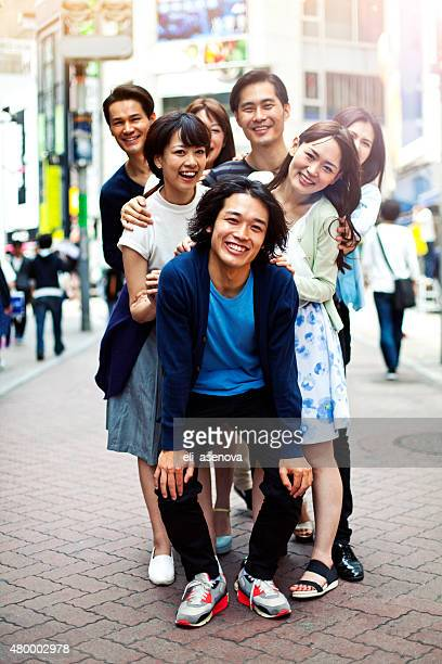 Young people hanging out against cityscape, Tokyo.