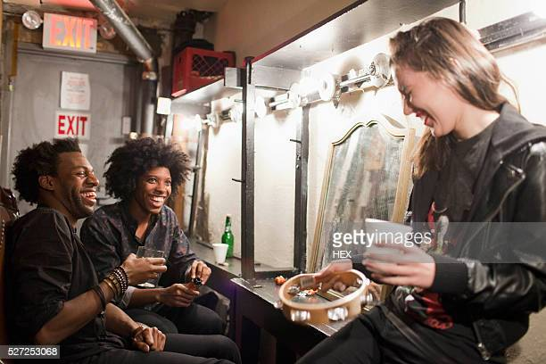 young people hanging out backstage at a theater - backstage stock pictures, royalty-free photos & images