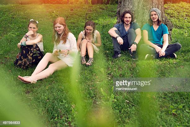 """young people hanging out in a park, boys are smoking. - """"martine doucet"""" or martinedoucet stock pictures, royalty-free photos & images"""