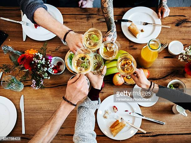 young people having a toast with a glass of wine. - food and drink fotografías e imágenes de stock