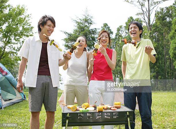 Young people having barbecue outside