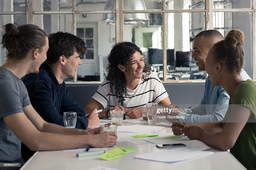 Young people having fun during meeting : Stock Photo