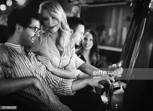 Young people having fun in casino.