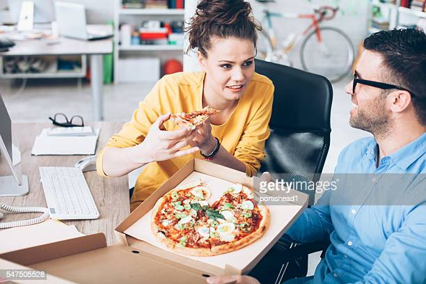 Young people having lunch break at workplace