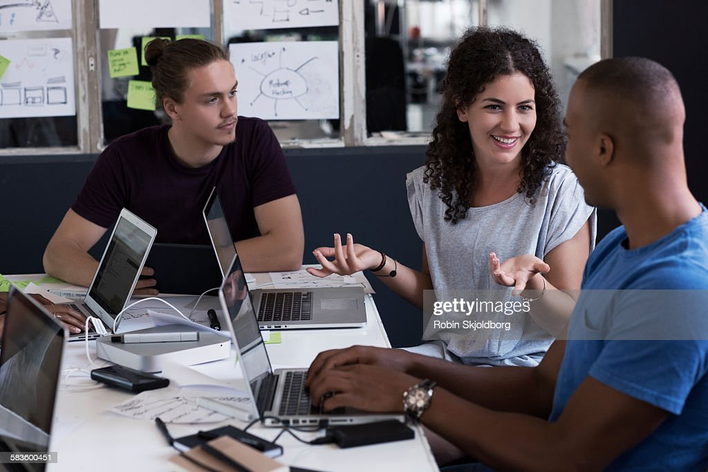 Young people having meeting in creative office : Stock Photo