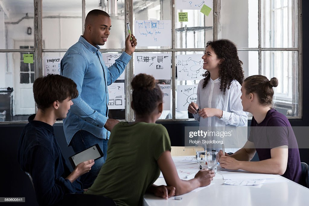 Young people having meeting : Stock Photo