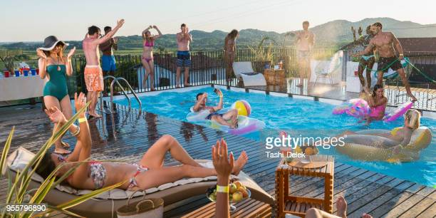 young people having pool party - pool party stock pictures, royalty-free photos & images