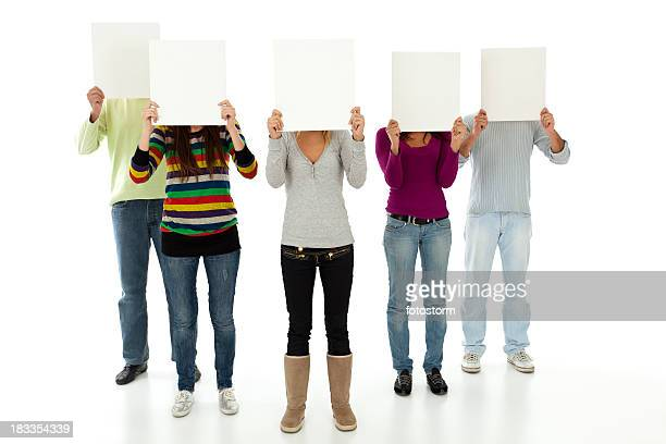 Young people holding empty boards in front of their faces