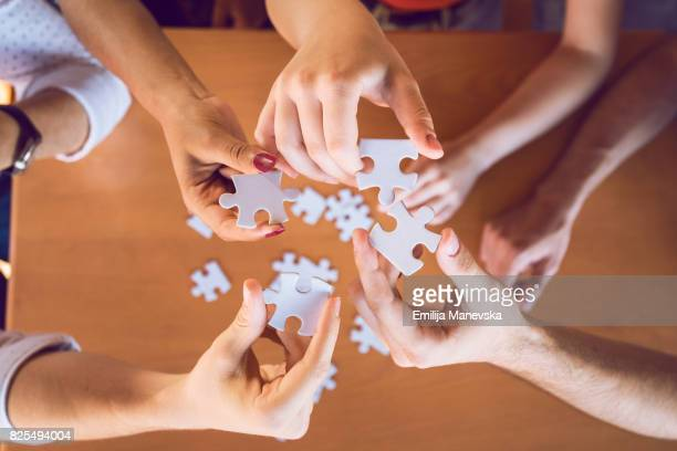 Young People Holding Puzzle Pieces