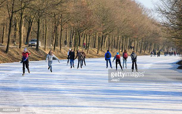 young people ice skating on frozen dutch canal (almelo albergen) - overijssel stock pictures, royalty-free photos & images