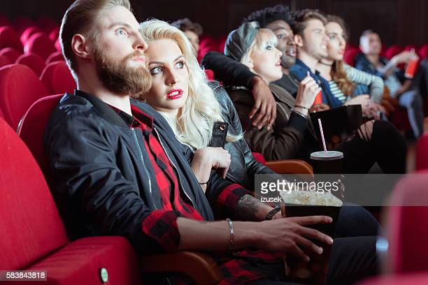 young people in 3d movie theater - izusek stock pictures, royalty-free photos & images