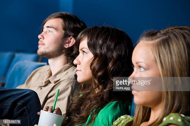young people in a movie theater - rich_legg stock photos and pictures
