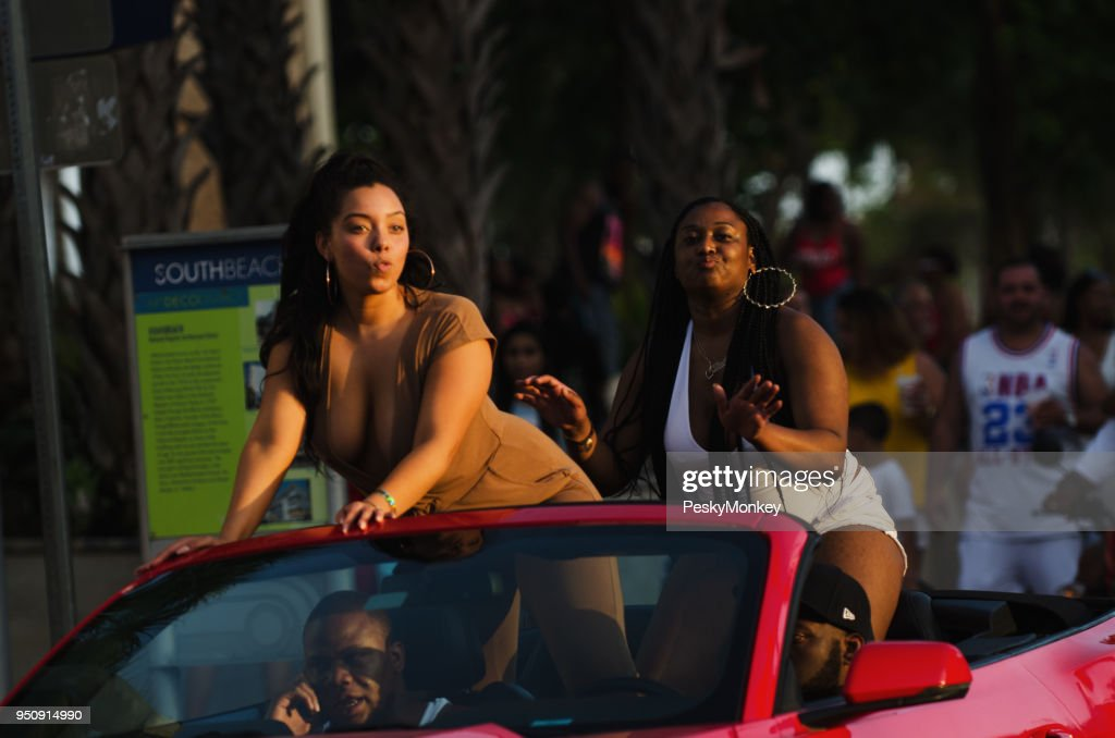 Young People in Convertible Ocean Drive South Beach Miami : Stock Photo