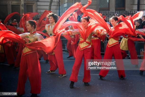 Young people in elaborate costumes participating in a parade to celebrate Chinese New Year in London, England, on 10th February 2008.