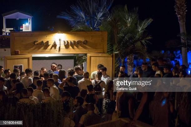 Young people in front of Cala Junco a beach where you go dancing during the nightlife in the Via Marina The Via Marina of Reggio Calabria consists of...
