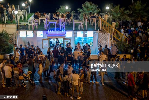 Young people in front of the Turque drink club during the nightlife in the Via Marina The Via Marina of Reggio Calabria consists of the four streets...