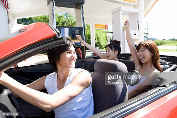 young people in gas station, smiling, saipan, usa - saipan stock pictures, royalty-free photos & images