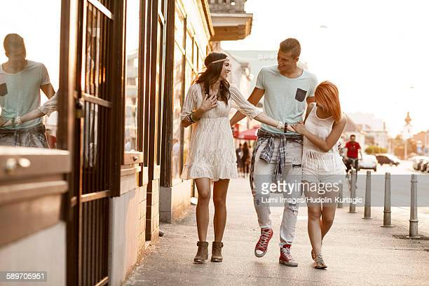 Young people in hippie style fashion walking on street