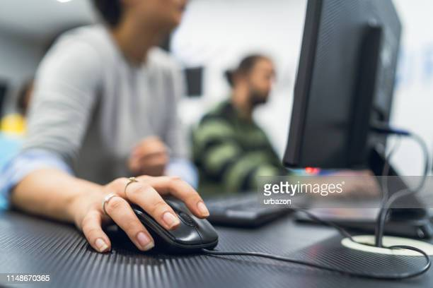 young people in programming school - computer mouse stock pictures, royalty-free photos & images