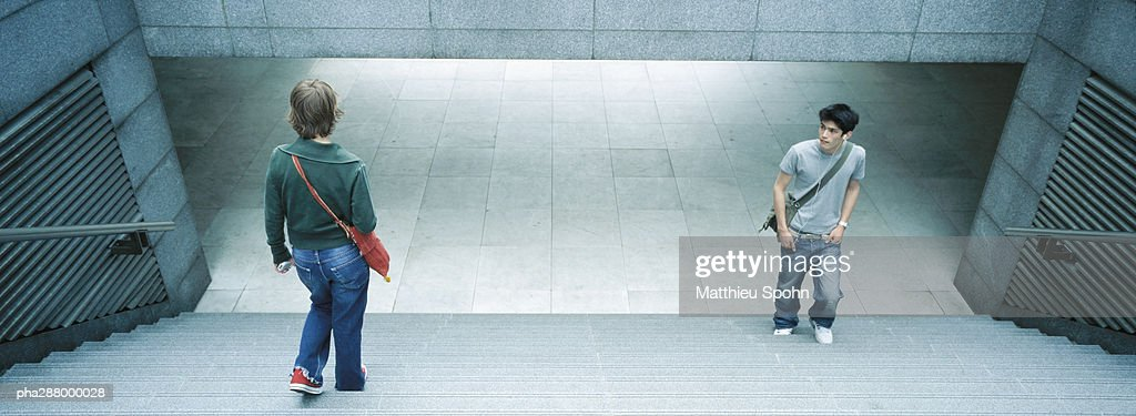 Young people in subway entrance : Stockfoto