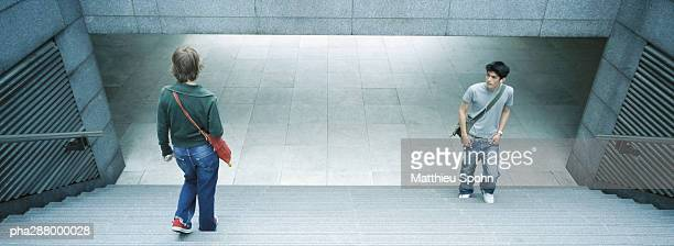 young people in subway entrance - moving past stock photos and pictures