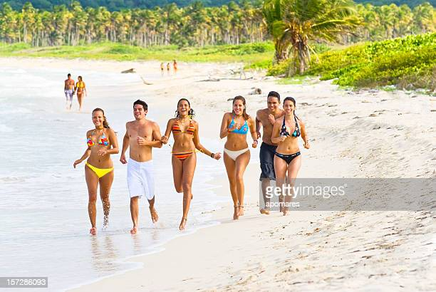 young people in the beach - medium group of people stock pictures, royalty-free photos & images