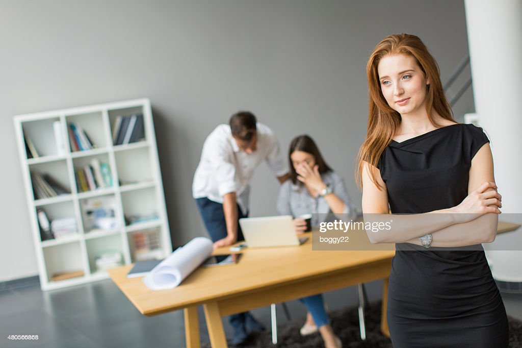 Young people in the office : Stock Photo
