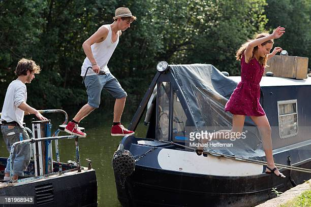 young people jumping off canal boat