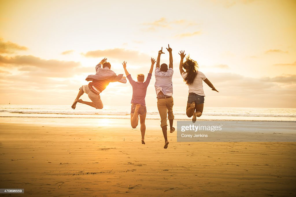 Young people jumping on Mission Beach, San Diego, California, USA : Stock Photo